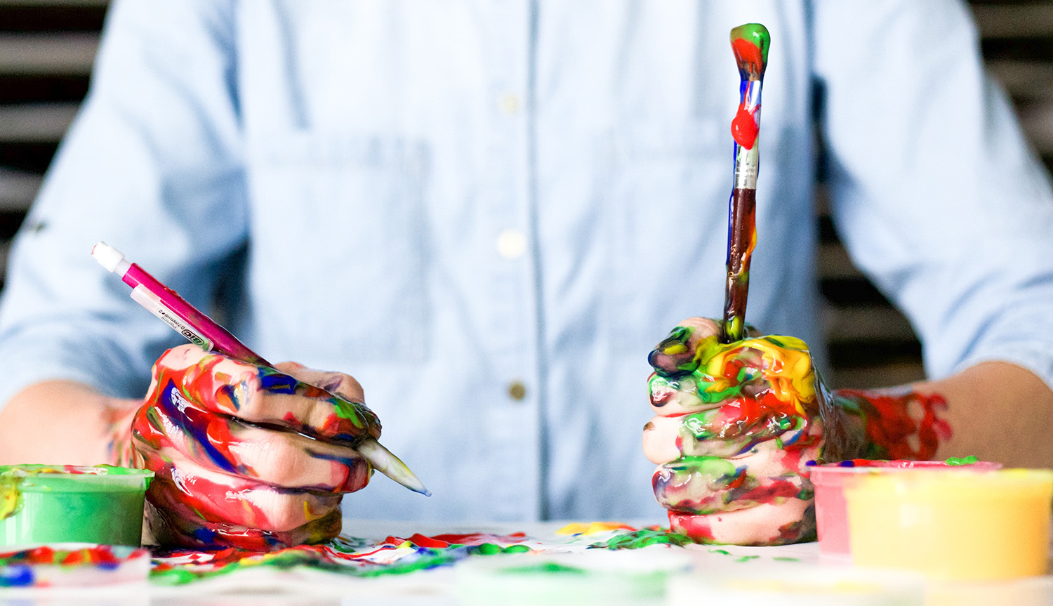 artist with paint brushes